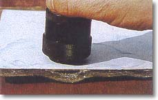 The damaged part of the laminate is revealed by moving the testing knob along the surface.